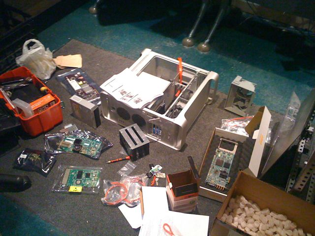 Building the server, notice the 3 drive case in the foreground